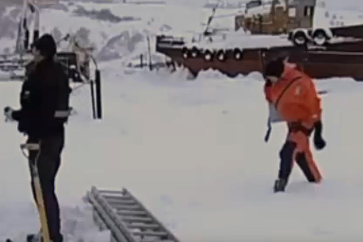 russian sailors save ice dog
