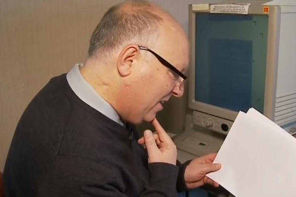 Mark Askins looking at paperwork