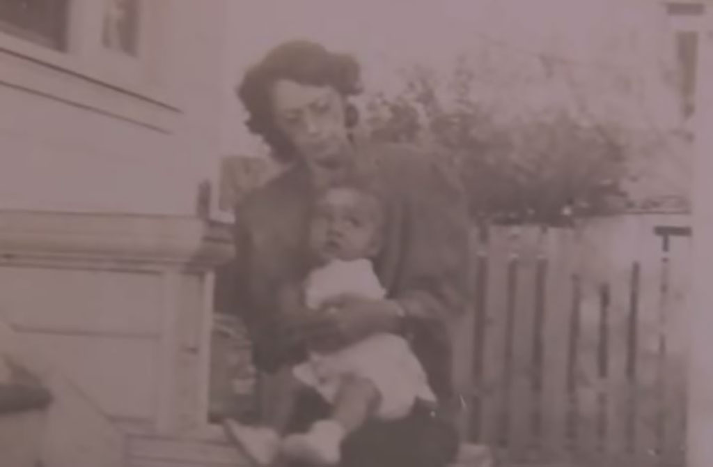 An old photo of a mother holding a child