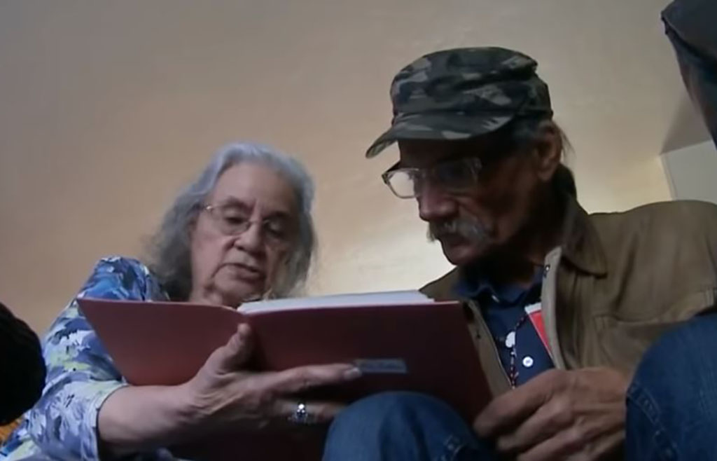 Pauline and Myers looking at an album together