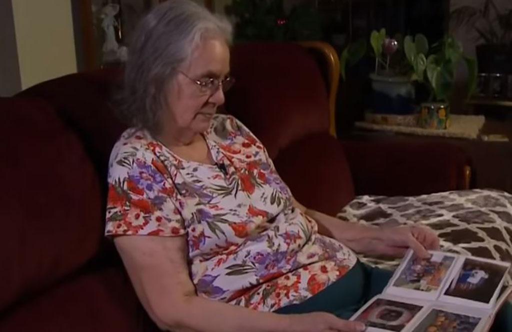 Pauline looking through an old photo album
