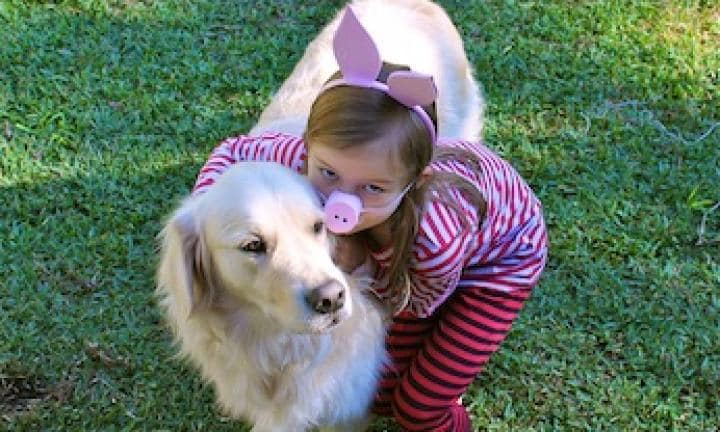 girl dressed as pig and dog