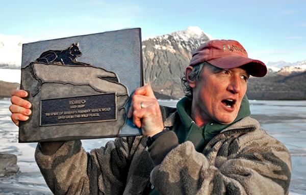 nick holding plaque