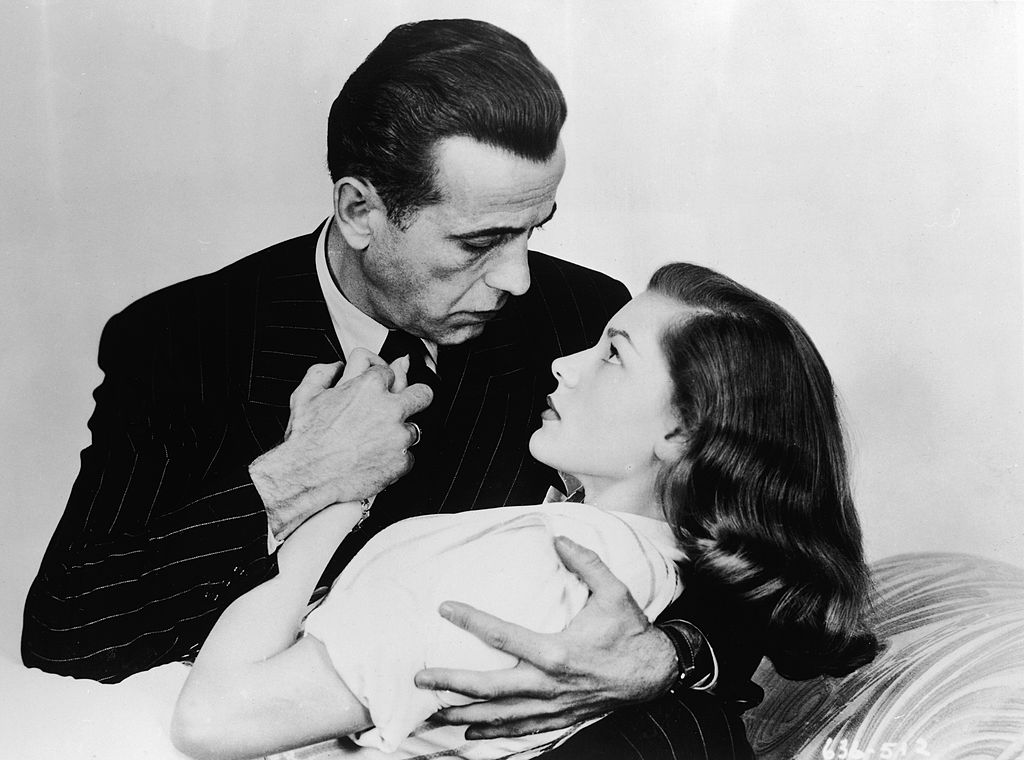 bacall and bogart in an embrace