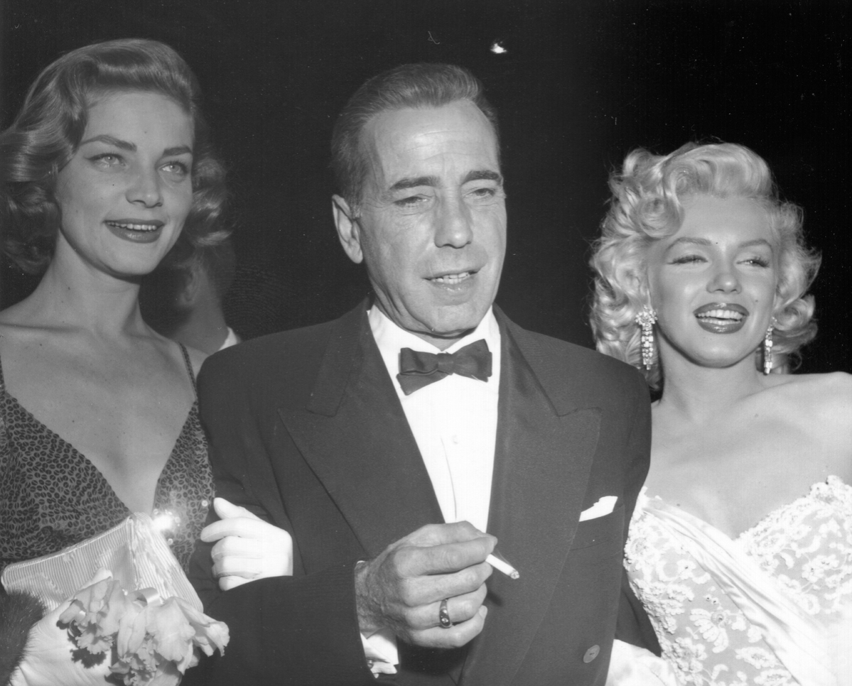 Actors Marilyn Monroe and Humphrey Bogart and Lauren Bacall attend the premiere of her movie