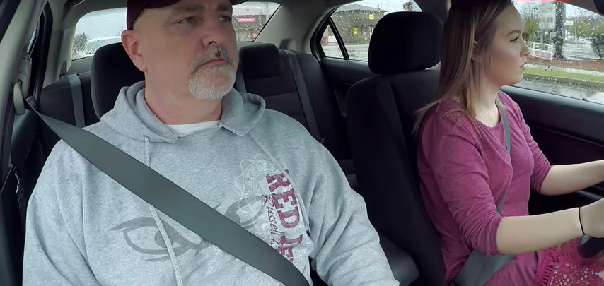 duke and his daughter driving the car