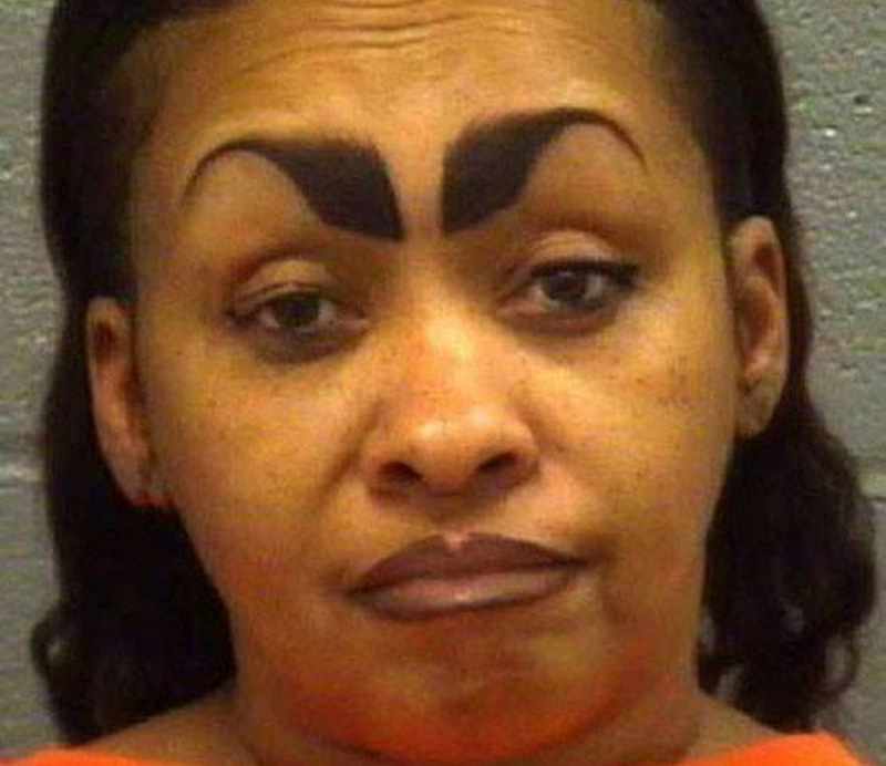a mugshot of a woman with eyebrows