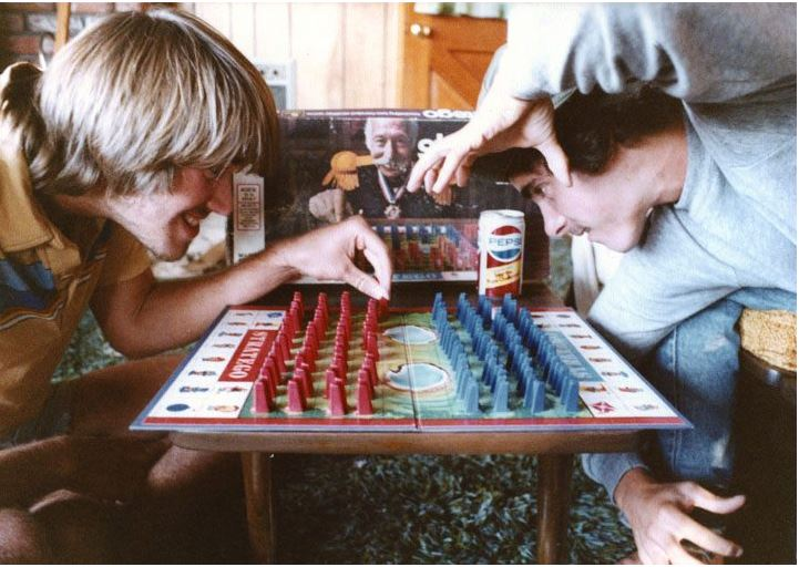 two friends playing a board game