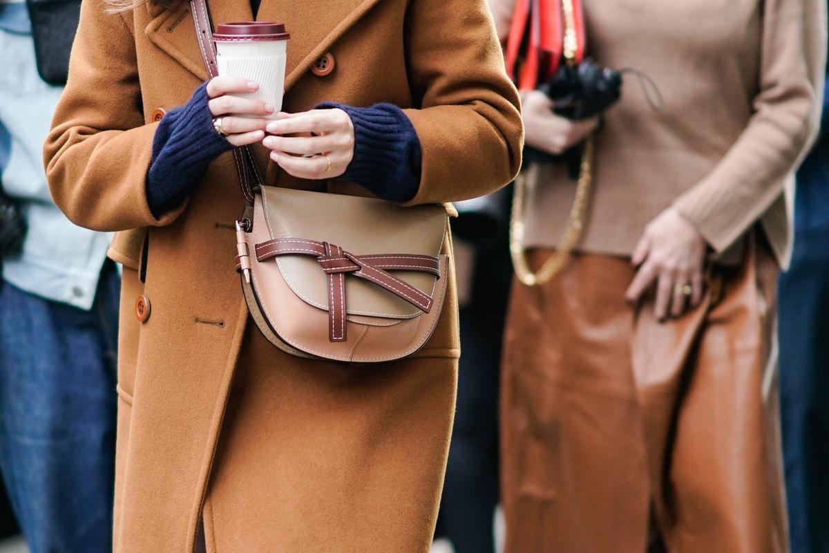 woman walking with coffee