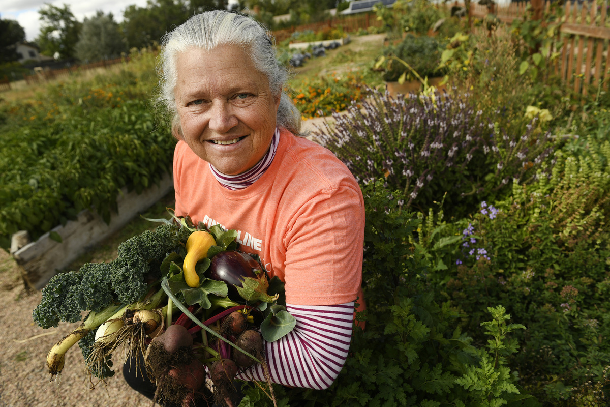 woman proud of veggies she grew