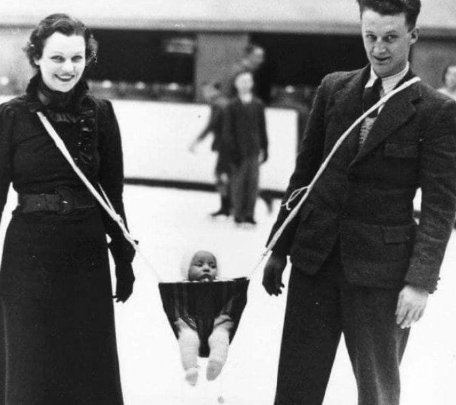 baby in slingshot ice skating