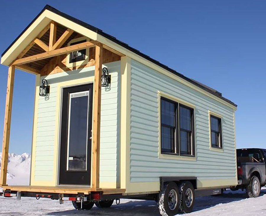 tiny home being pulled by trailer