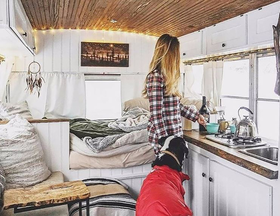 woman with dog living in tiny house
