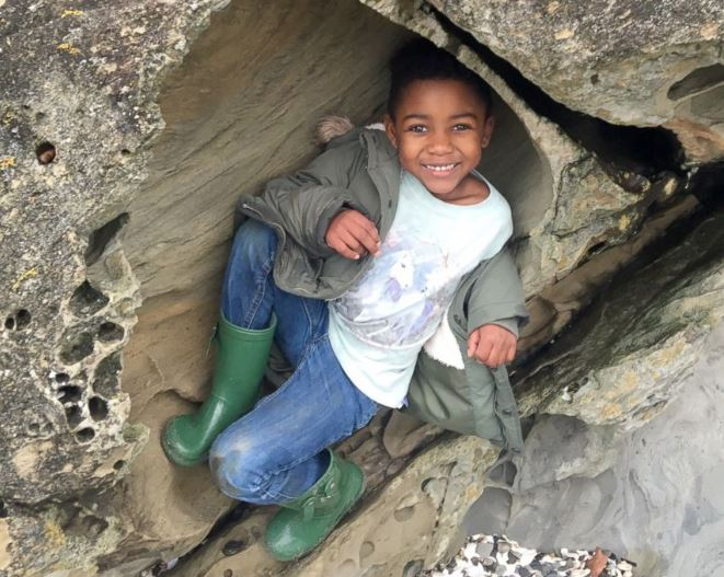 Three-year-old Michael climbing rocks