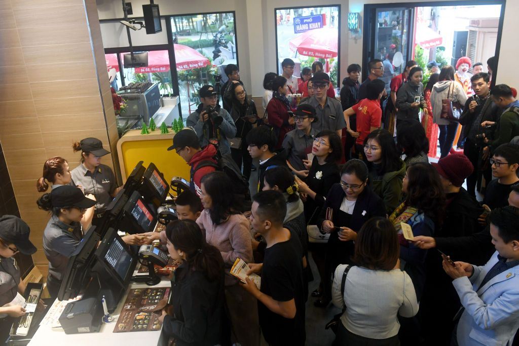 Customers crowd a McDonald's.
