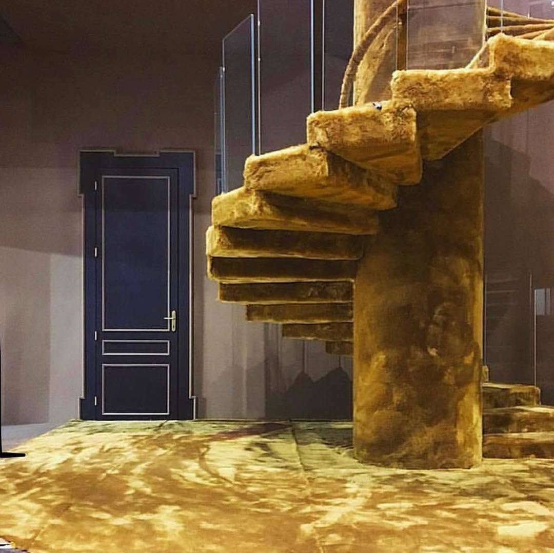 floor and stairs covered in musstard yellow carpet