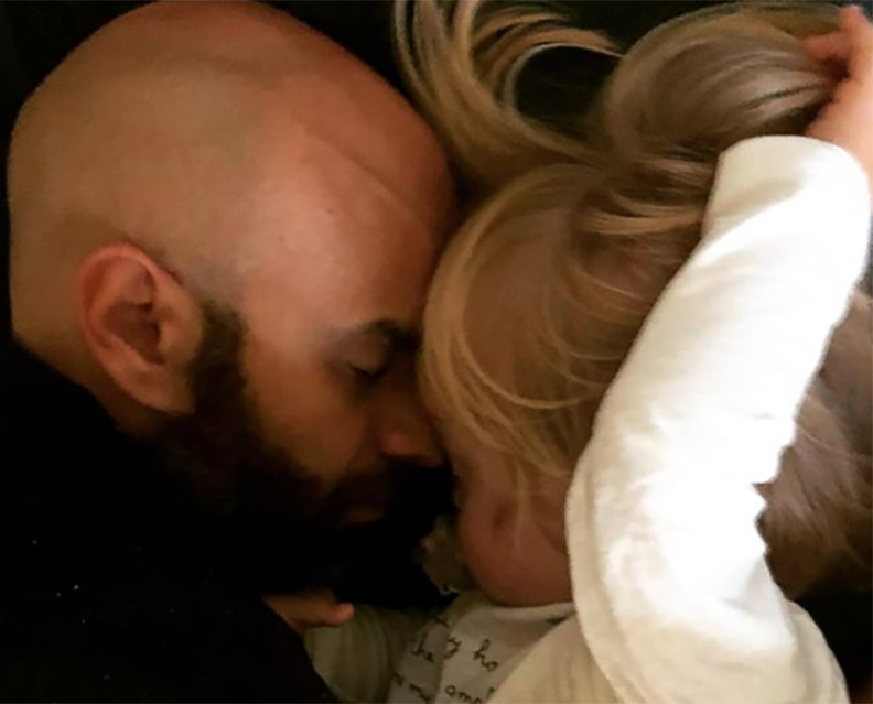 Luca and Alba snuggle with their faces together.