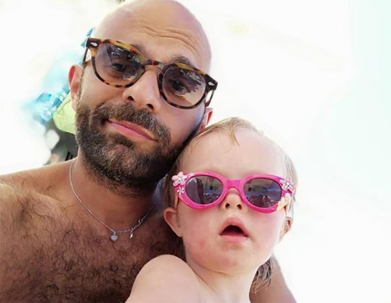 Luca and Alba stare at the camera in sunglasses.
