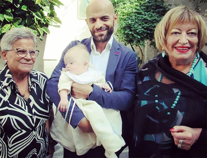 Luca holds Alba while posing beside his mom and another relative.