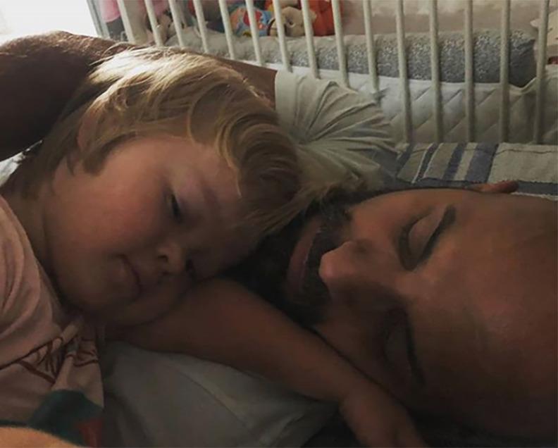 Alba lays on Luca's chest.