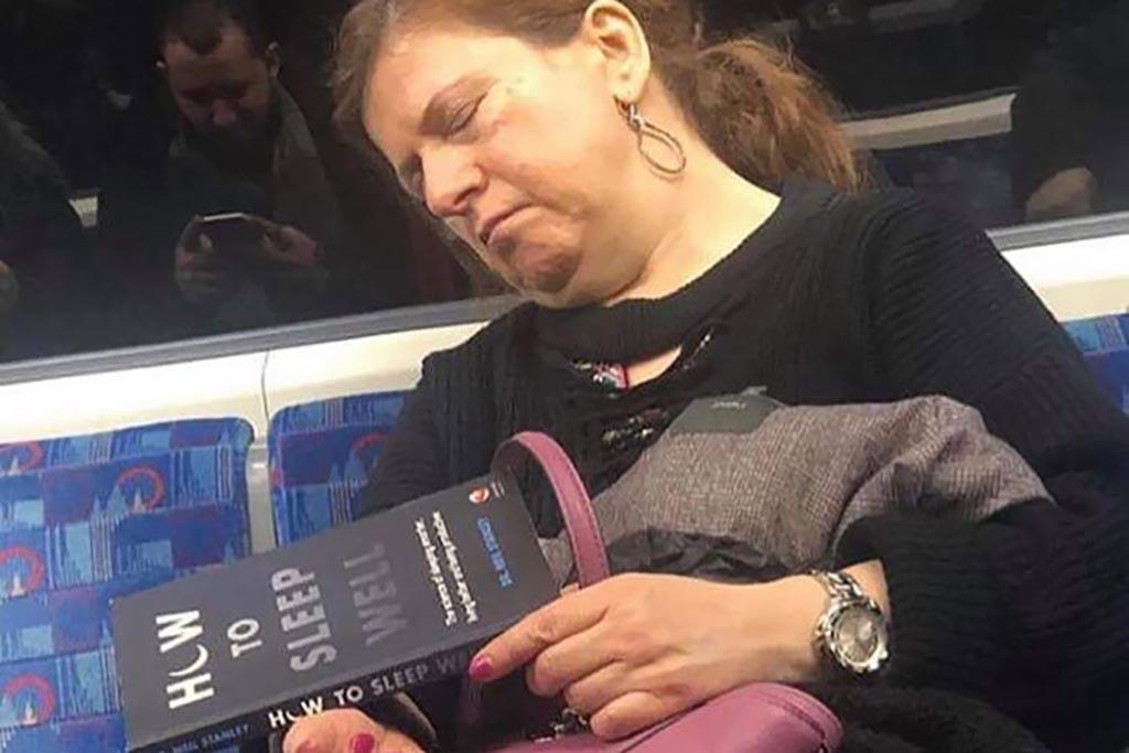Woman asleep with sleeping book