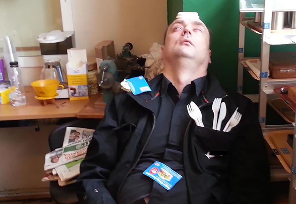 Guy sleeping with his eyes open