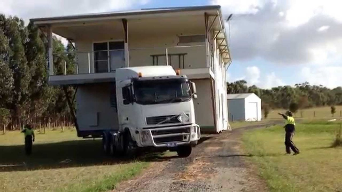 house being moved on a truck