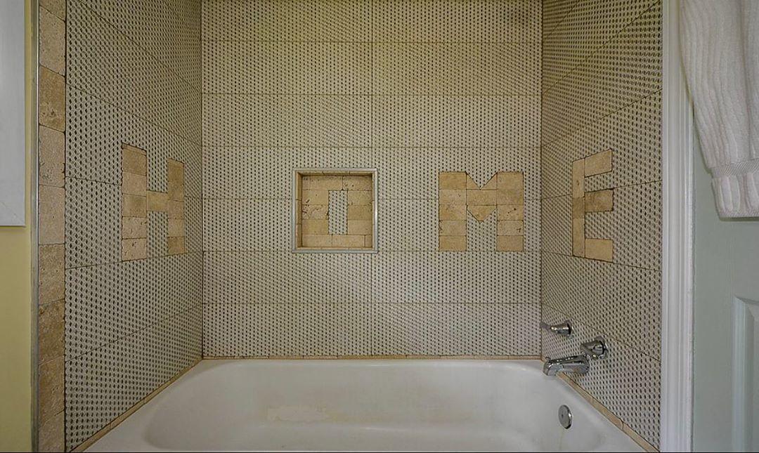 the word 'home' spelt with bathroom tiles