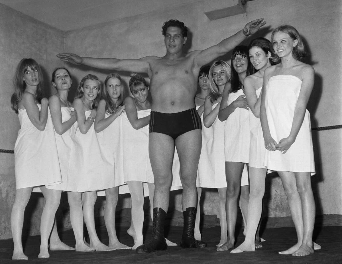 andre the giant standing with group of women