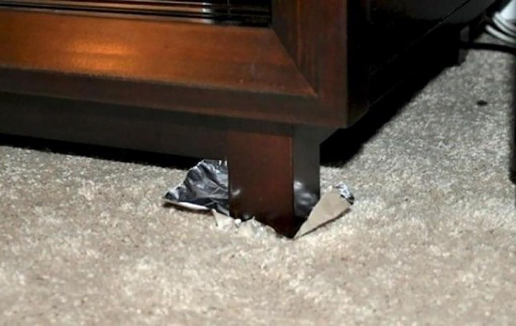 Piece of foil underneath furniture leg