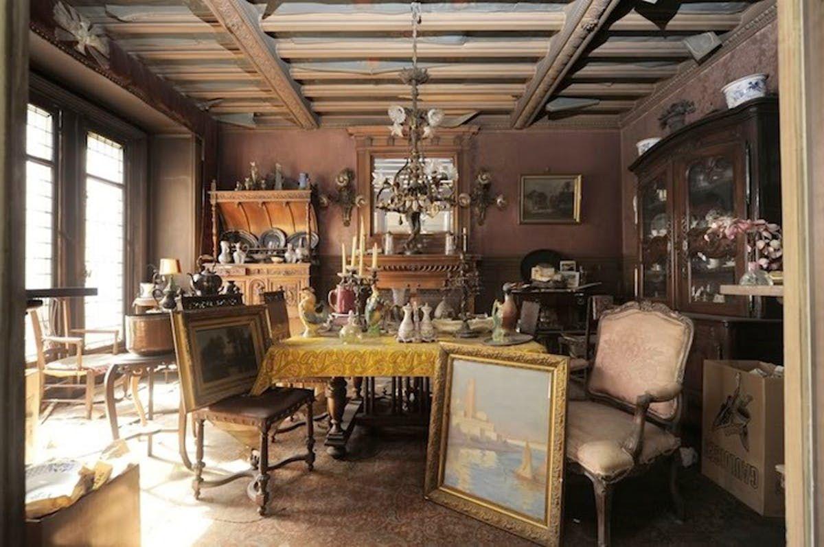 A dining room is full of antique items.