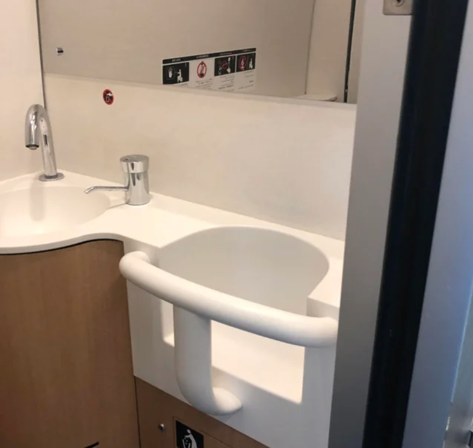washroom on train has seat for child