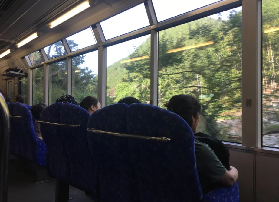 train seats face out large gallery windows