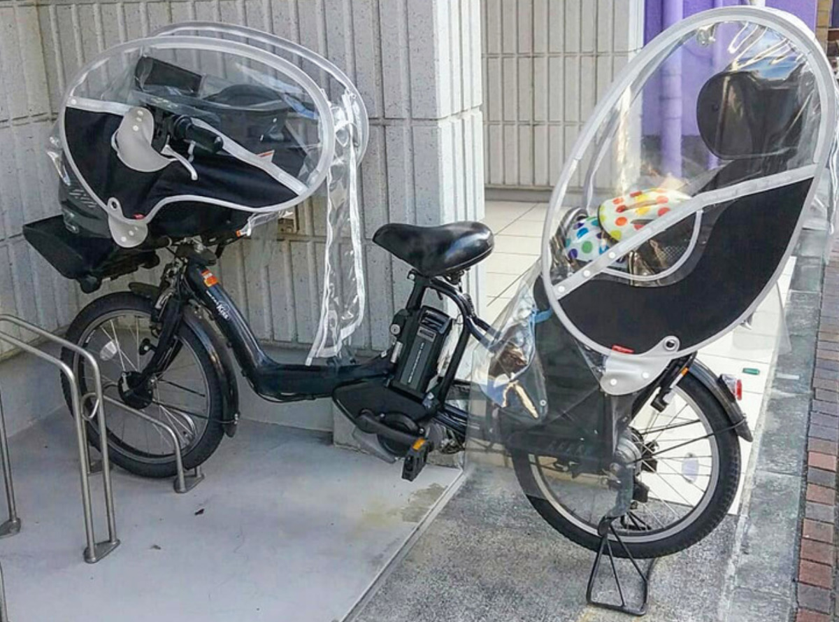 bicycle with space for two children and parent