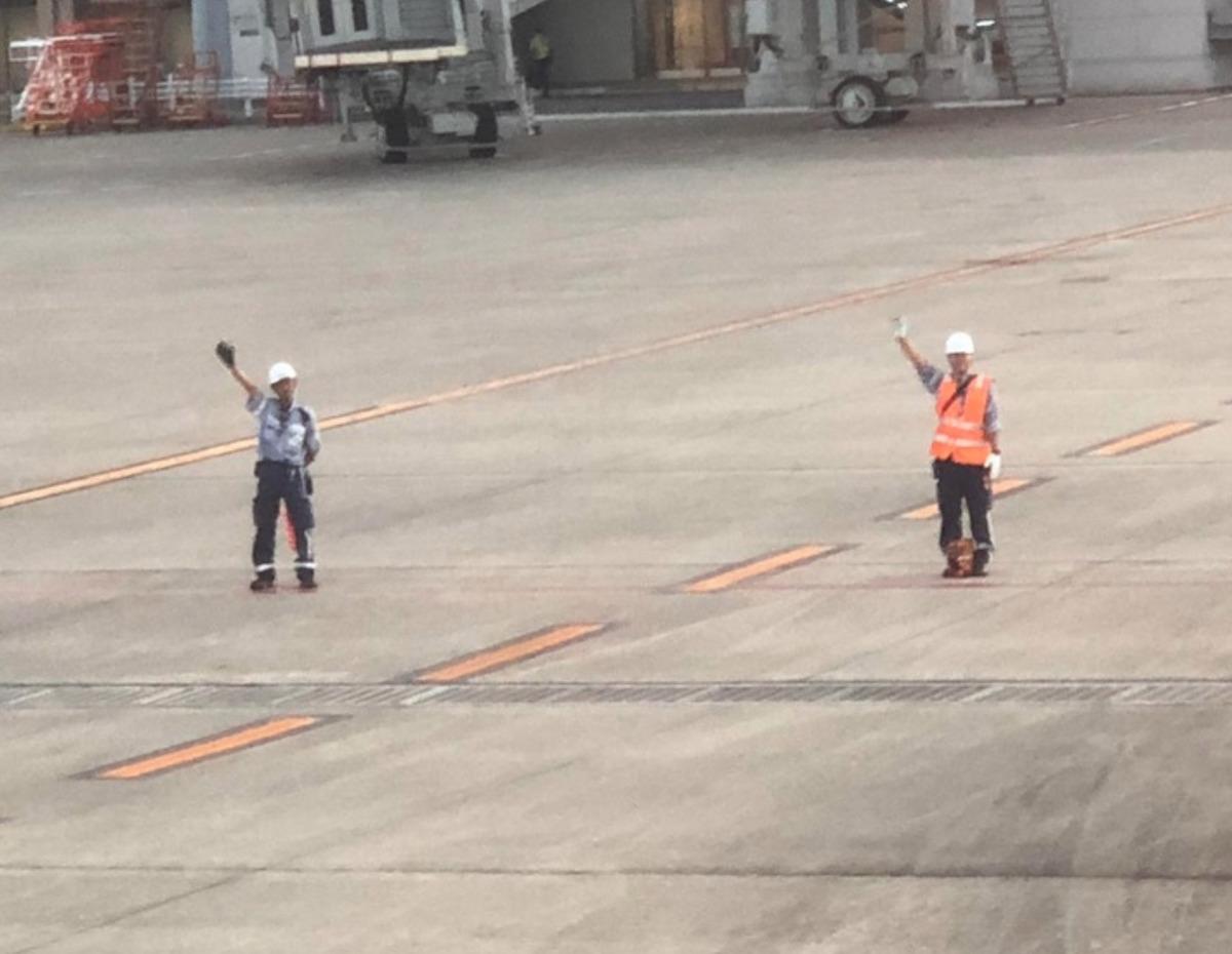 Airport ground crew waving