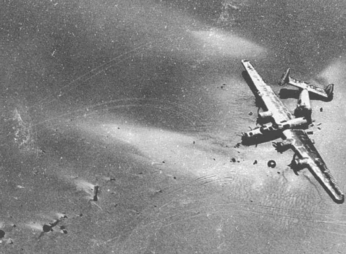 The crash site of Lady Be Good is viewed from an aerial perspective.