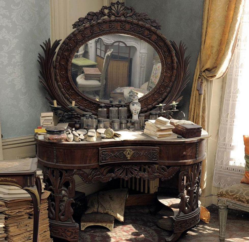 Marthe's vanity sits in the corner and is covered with glass bottles and wooden hair brushes.