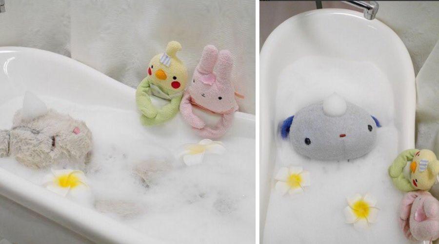 some stuffed animals having a bath