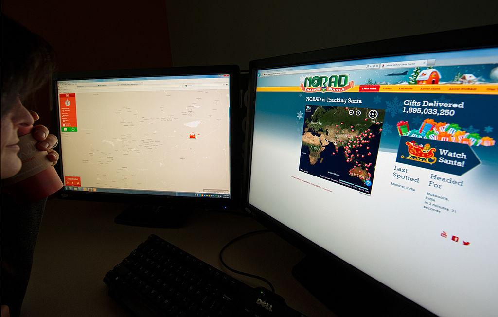Woman using NORAD Santa Tracker