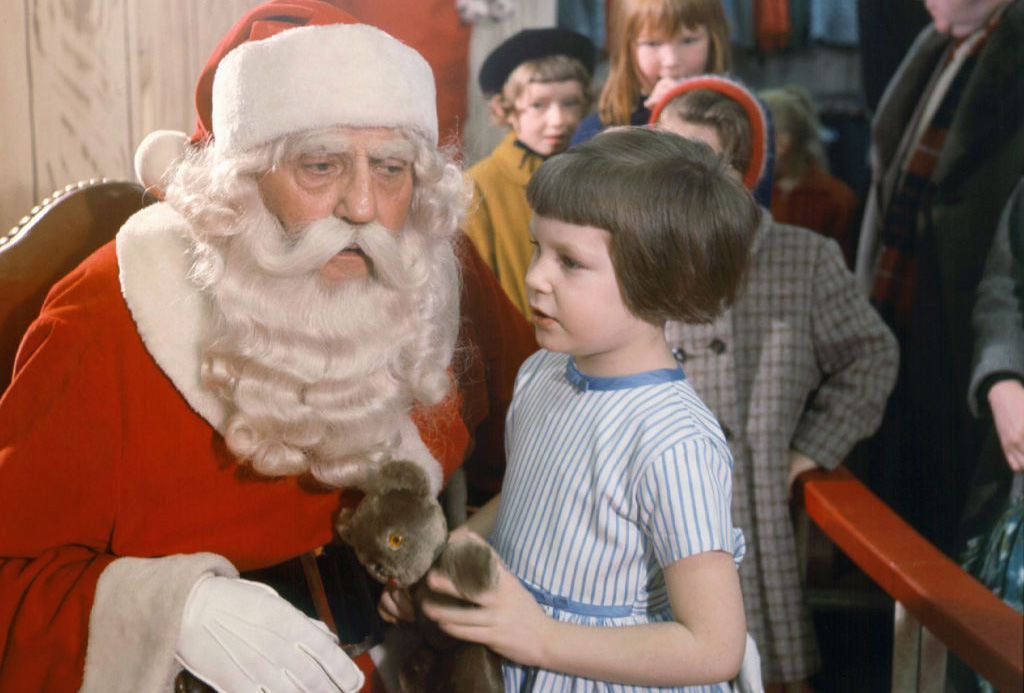 Little girl talking to Santa