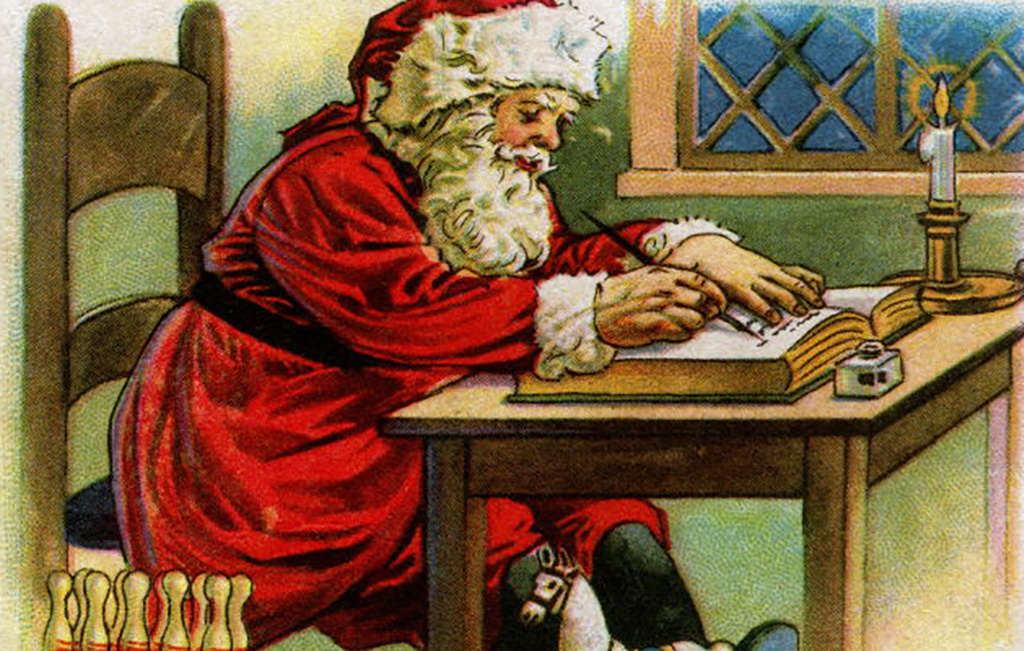 Santa writing in his book