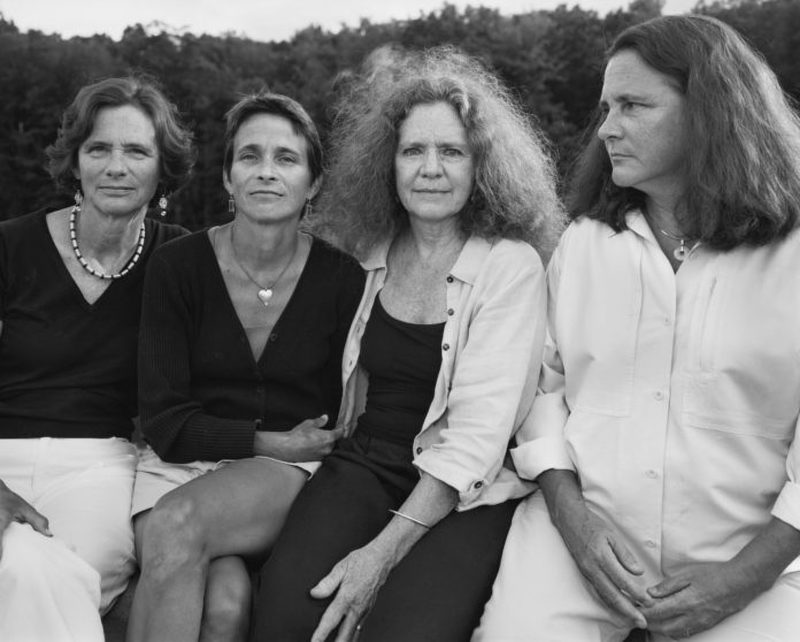 four sisters sitting together