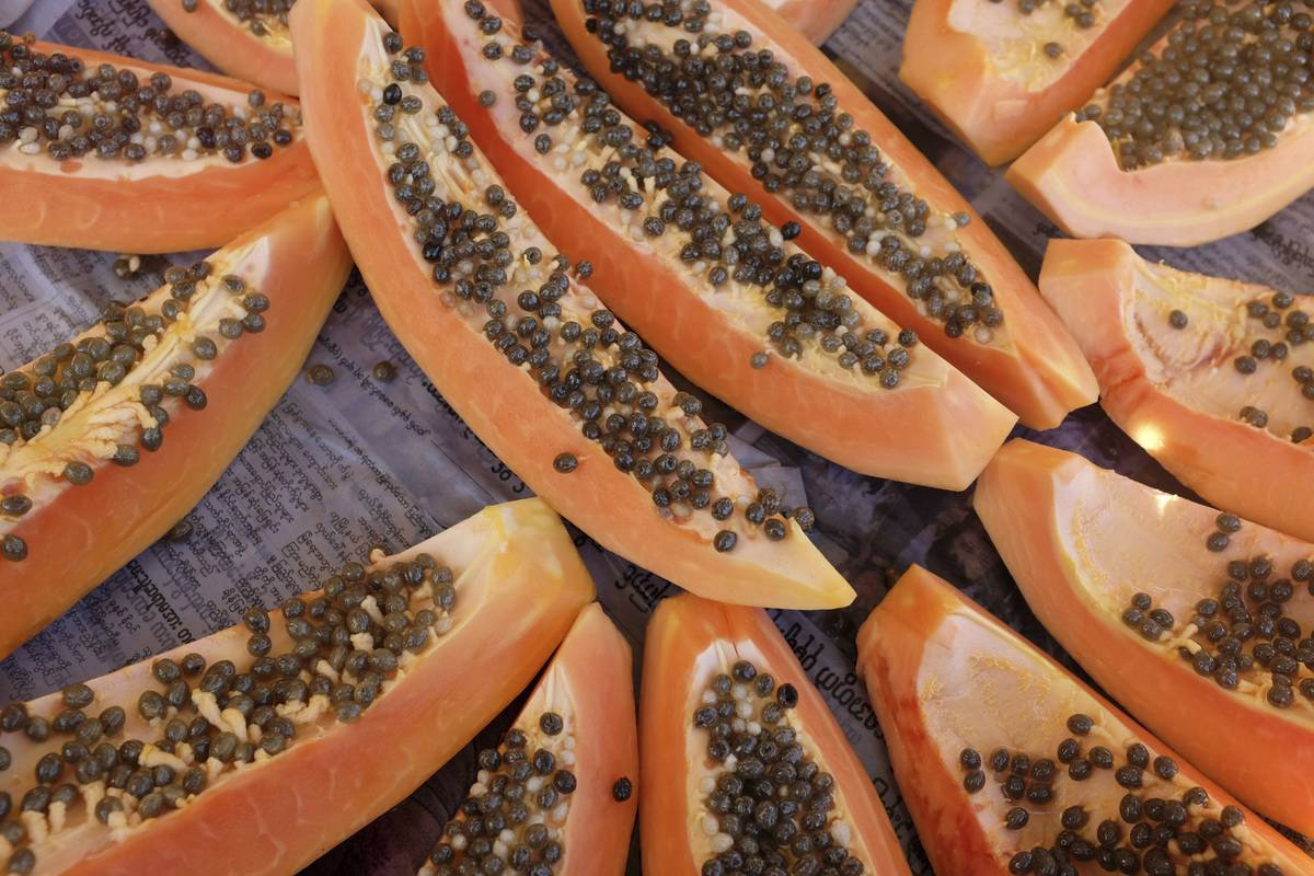 Fresh papaya slices lay on a table.