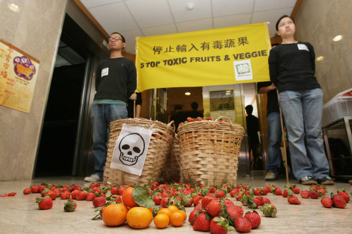 Members of environmental group Greenpeace protest against pesticide fruits and vegetables.