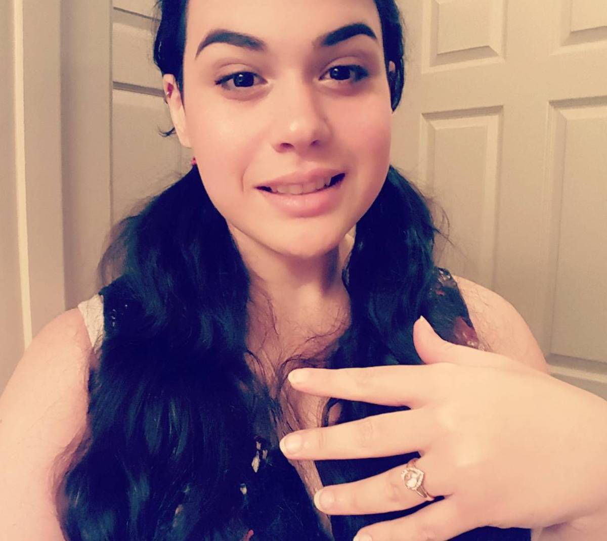 Amber shows off her engagement ring.