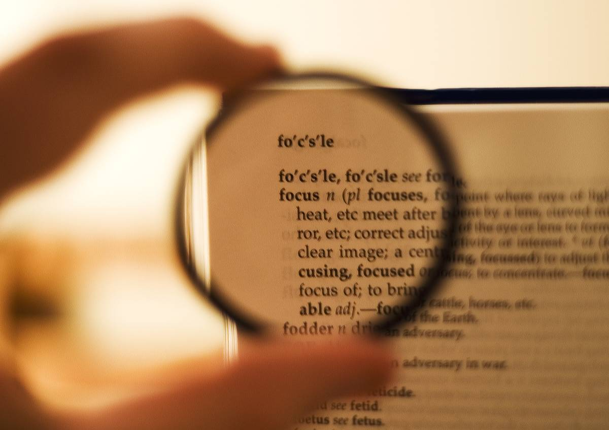 A lens places a dictionary page in focus.