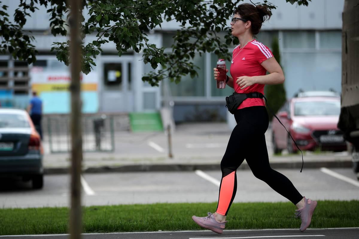 A woman jogs outside.