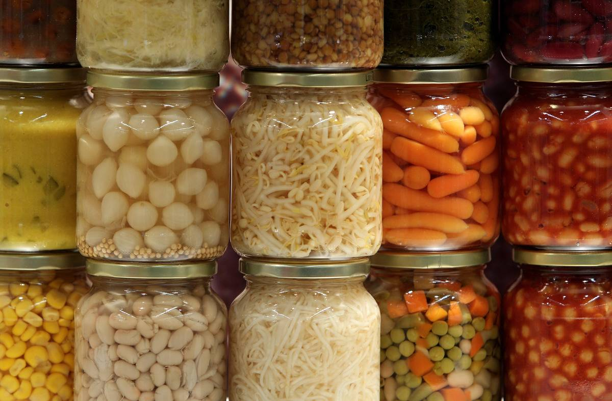 Canned vegetables are stacked and on display.