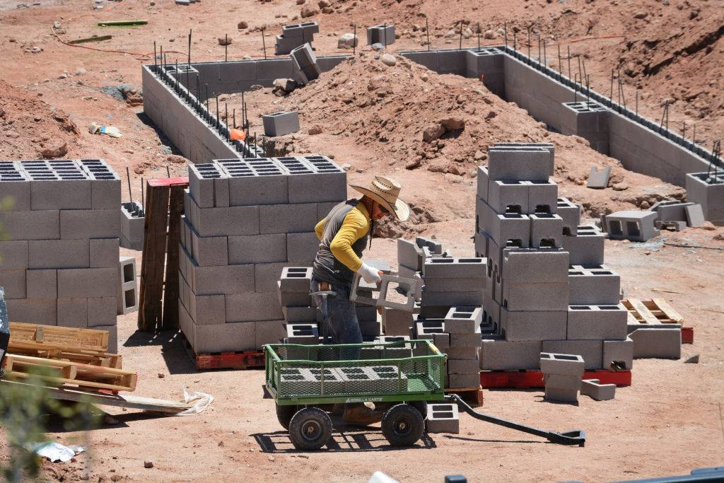 Man working with cinder blocks