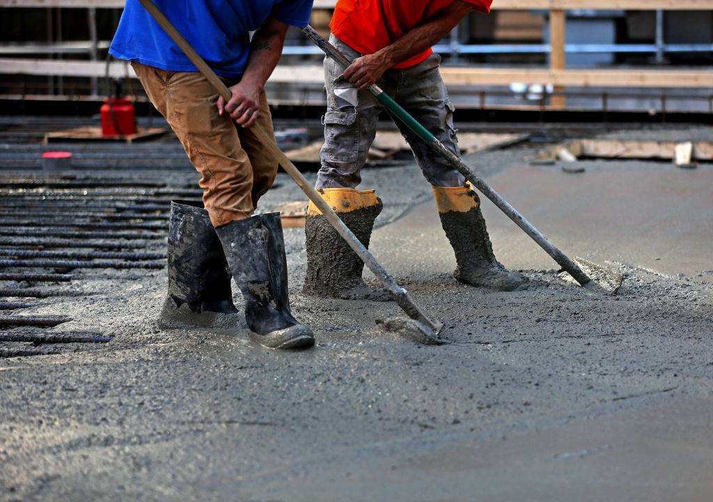 Men working with concrete